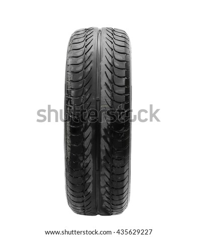 wet old tire isolated on white background - stock photo