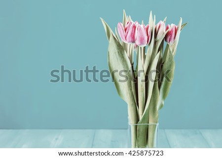 Wet Pink Tulip Flowers In Vase - stock photo