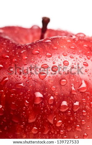wet red delicious apple close-up - stock photo
