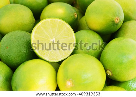Wet ripe limes background - stock photo