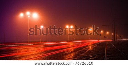 wet road at the night - stock photo