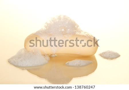 Wet soap with foam isolated on white - stock photo