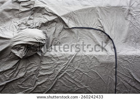 Wet surface of the gray car cover. Close up. - stock photo