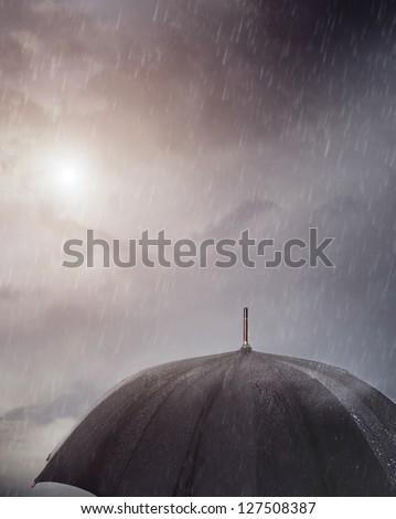 Wet umbrella under the rain - stock photo
