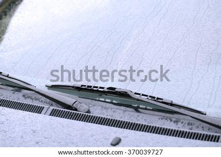 Wet windshield wiper - stock photo