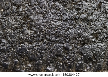 wet worn tire of the truck background, tire texture background  - stock photo
