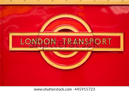 WEYBRIDGE, SURREY, UK - AUGUST 9, 2015: A vintage Red London Transport badge on a vintage London bus at the London Bus Museum at Brookland Motor Museum in August, 2015. - stock photo
