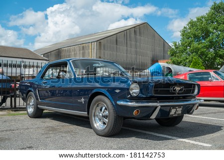 WEYBRIDGE, SURREY, UK - AUGUST 18:  1965 Blue Ford Mustang Coupe on show at the annual Brooklands Motor Museums Mustang and Anything American Day in August 18 2013. - stock photo