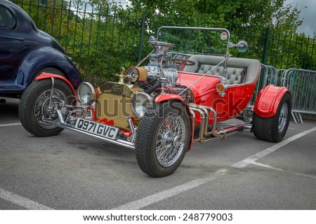 WEYBRIDGE, SURRY, UK - AUGUST 18:  1920s red Ford Model T on show at the annual Brooklands Motor Museums Mustang and Anything American Day in August 2013 - stock photo