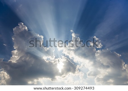 What a beautiful sunbeam coming out of huge gorgeous clouds - stock photo
