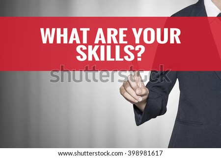 What Are Your Skills word on virtual screen push by business woman red tab - stock photo