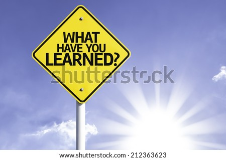 What Have You Learned? road sign with sun background  - stock photo