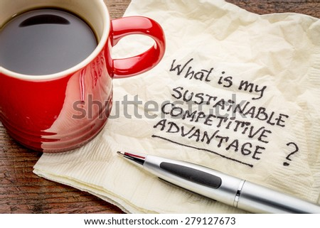 What is my sustainable competitive advantage question - handwriting on a napkin with a cup of coffee - stock photo