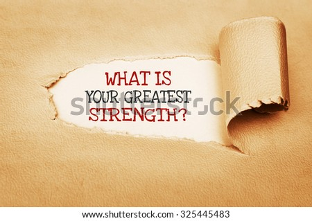 What is Your Greatest Strength? text written behind a torn paper - stock photo