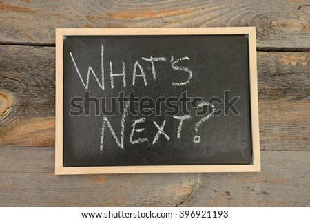 What's next written in chalk on a chalkboard on a rustic background - stock photo