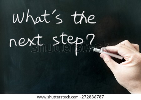 What's the next step words written on the blackboard using chalk - stock photo