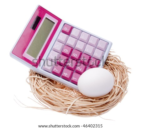 What's your nest egg worth?  Calculate the cost with this image of a nest, egg and bright pink calculator isolated on white with a clipping path. - stock photo