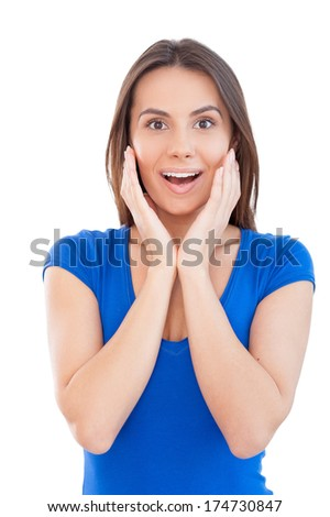 What the great news! Beautiful young smiling woman looking at camera and gesturing while standing isolated on white - stock photo