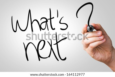 Whats next hand writing with a black mark on a transparent board - stock photo