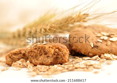 Wheat and biscuits on a white background - stock photo