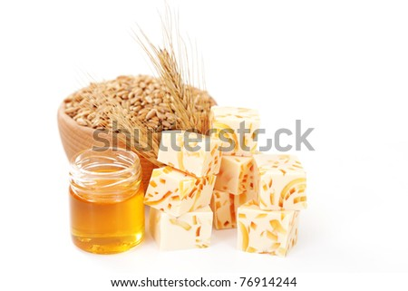 wheat and honey soap on white background - beauty treatment - stock photo