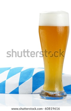 wheat beer with bavarian towel on white background - stock photo