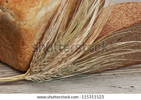 wheat bread wheat bread on a wooden table - stock photo