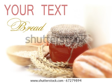 Wheat bread with honey jar - stock photo