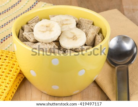 wheat breakfast cereal with banana - stock photo