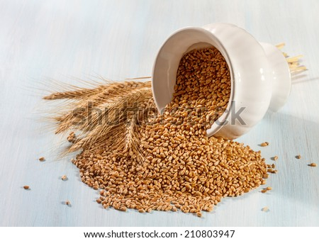 Wheat ears on a wooden background.  - stock photo