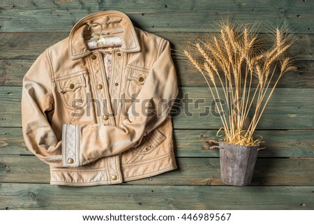 Wheat Ears on the Wooden Table. Sheaf of Wheat over Wood Background. Harvest concept. - stock photo