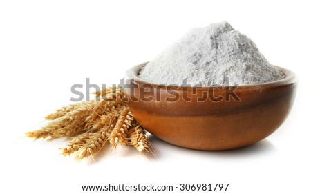 Wheat flour in wooden bowl isolated on white - stock photo