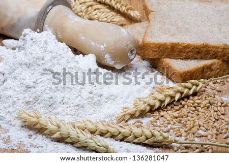 Wheat grains and wheat flour.Grain And Cereal Products - stock photo