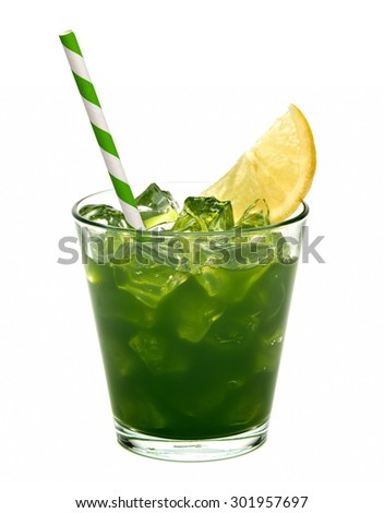 Wheat grass juice with lemon slice in glass isolated on white background - stock photo