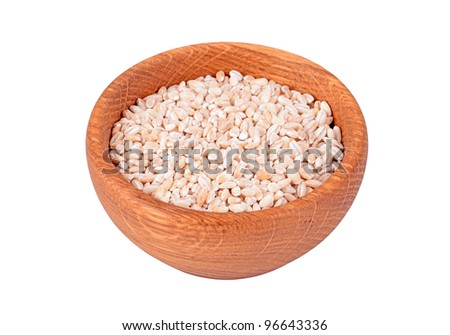 Wheat in a wooden bowl, isolated on white background - stock photo