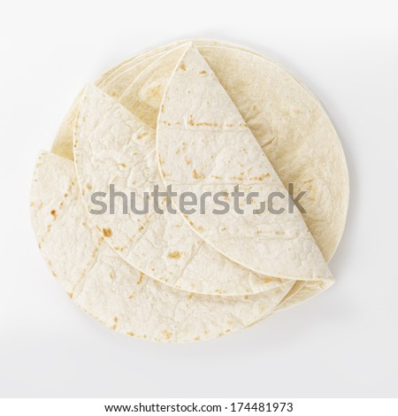 wheat round tortillas, from aboveon white background - stock photo
