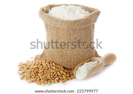 Wheat seed and flour in small burlap sack - stock photo