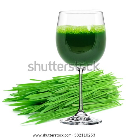 wheatgrass juice in a glass isolated on a white background - stock photo