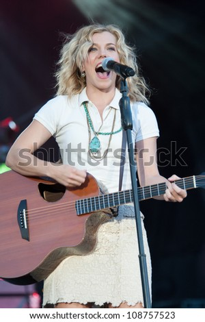 WHEATLAND, CA - JULY 26: Kimberly Perry of The Band Perry performs in part of Brad Paisley's Virtual Reality Tour 2012 at Sleep Train Amphitheatre on July 26, 2012 in Wheatland, California. - stock photo