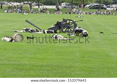WHEATON, ILLINOIS/USA - SEPTEMBER 7: American Revolutionary War (1775-1783) reenactment on September 7, 2013, in Wheaton, IL. Actor-soldiers of Continental Army run past fallen comrades in battle.. - stock photo
