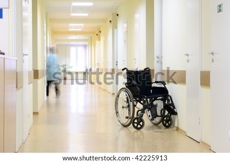 Wheel chair at the hospital corridor. - stock photo