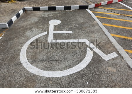 Wheel chair symbol in parking lot , Car park for wheel chair in thailand. - stock photo