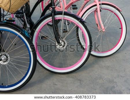 Wheel detail of three bikes - stock photo