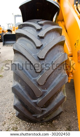 wheel grand loader's. Close-up - stock photo