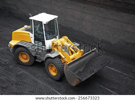Wheel loader machine loading coal - stock photo