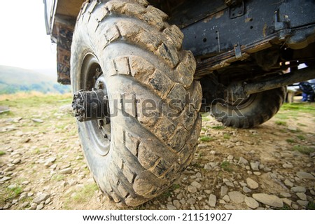 wheel of the car in the mud - stock photo