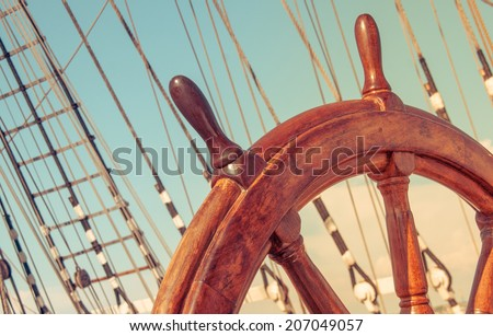 Wheel or helm on an old ship. - stock photo