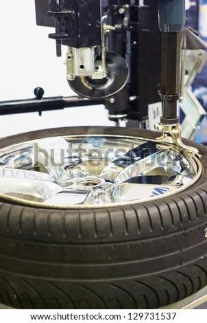 wheel repair in auto service station - stock photo
