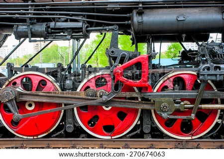 wheel steam locomotive close up on the rails - stock photo
