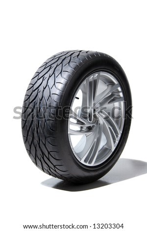 Wheel with steel rim over the white background - stock photo